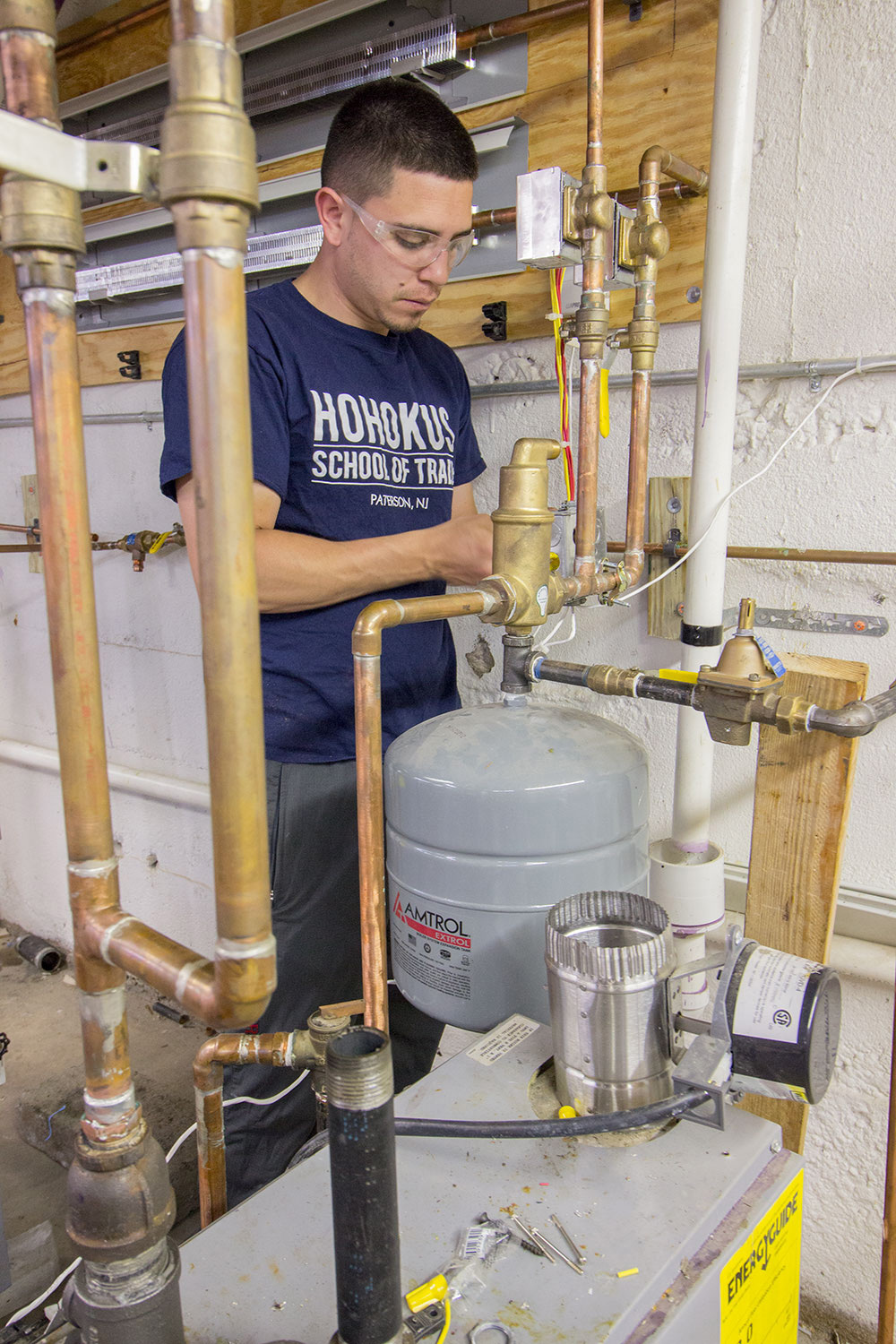 Plumbing apprenticeship student practices piping