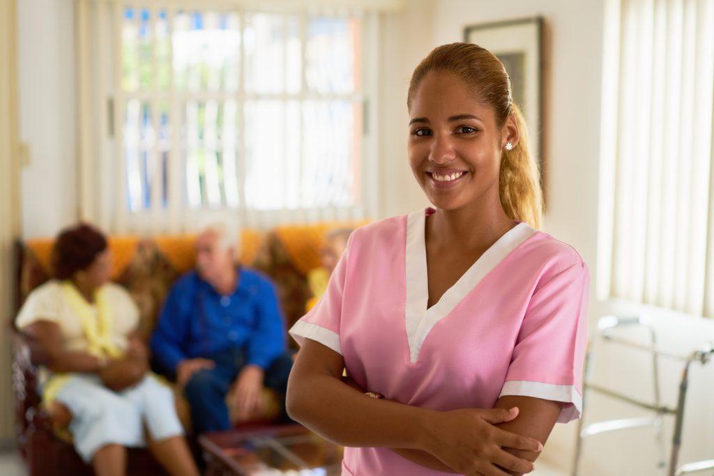 Bilingual Nursing Program. Happy Nurse Smiling with patients. LPN Program at Eastwick College