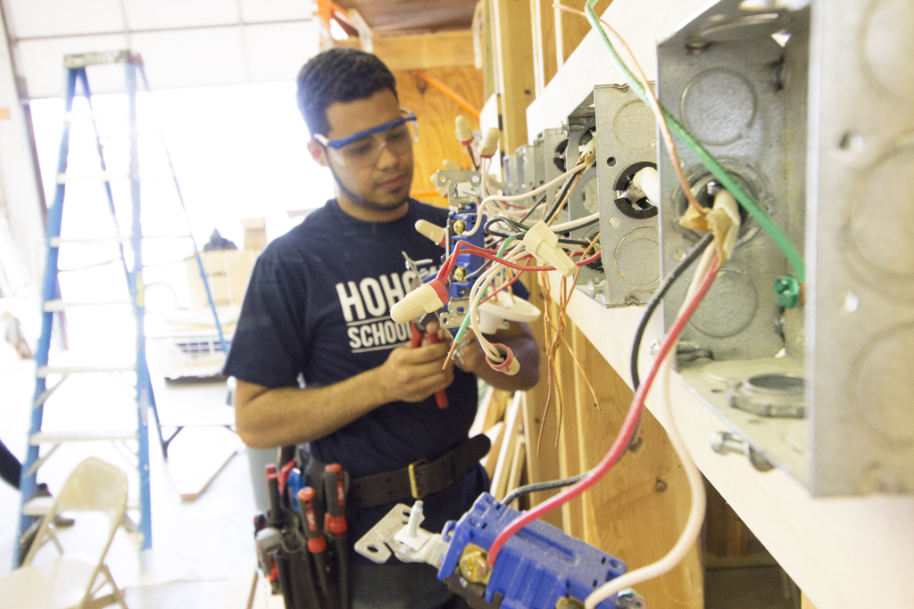 Electrician Apprenticeship student practices wiring