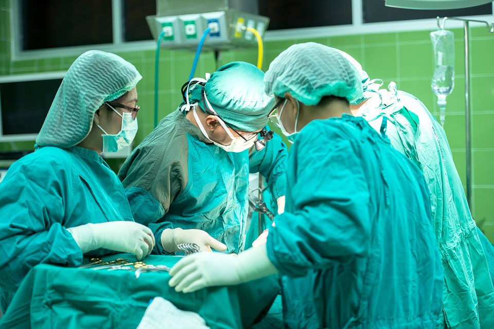 Operation room with surgeons performing surgery
