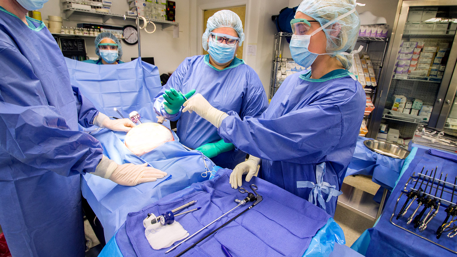 Surgical Technician students practice performing surgery together in mock operation room