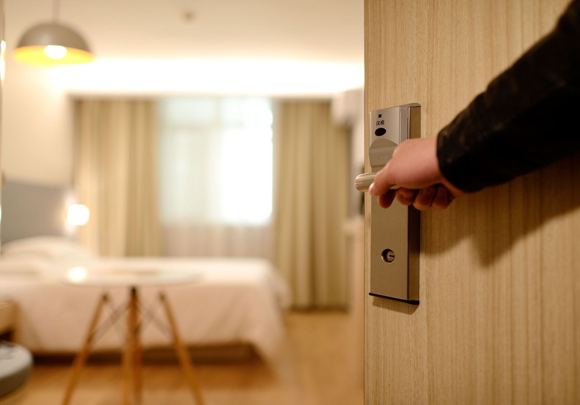 hotel personnel opening the door to a room to be hospitable