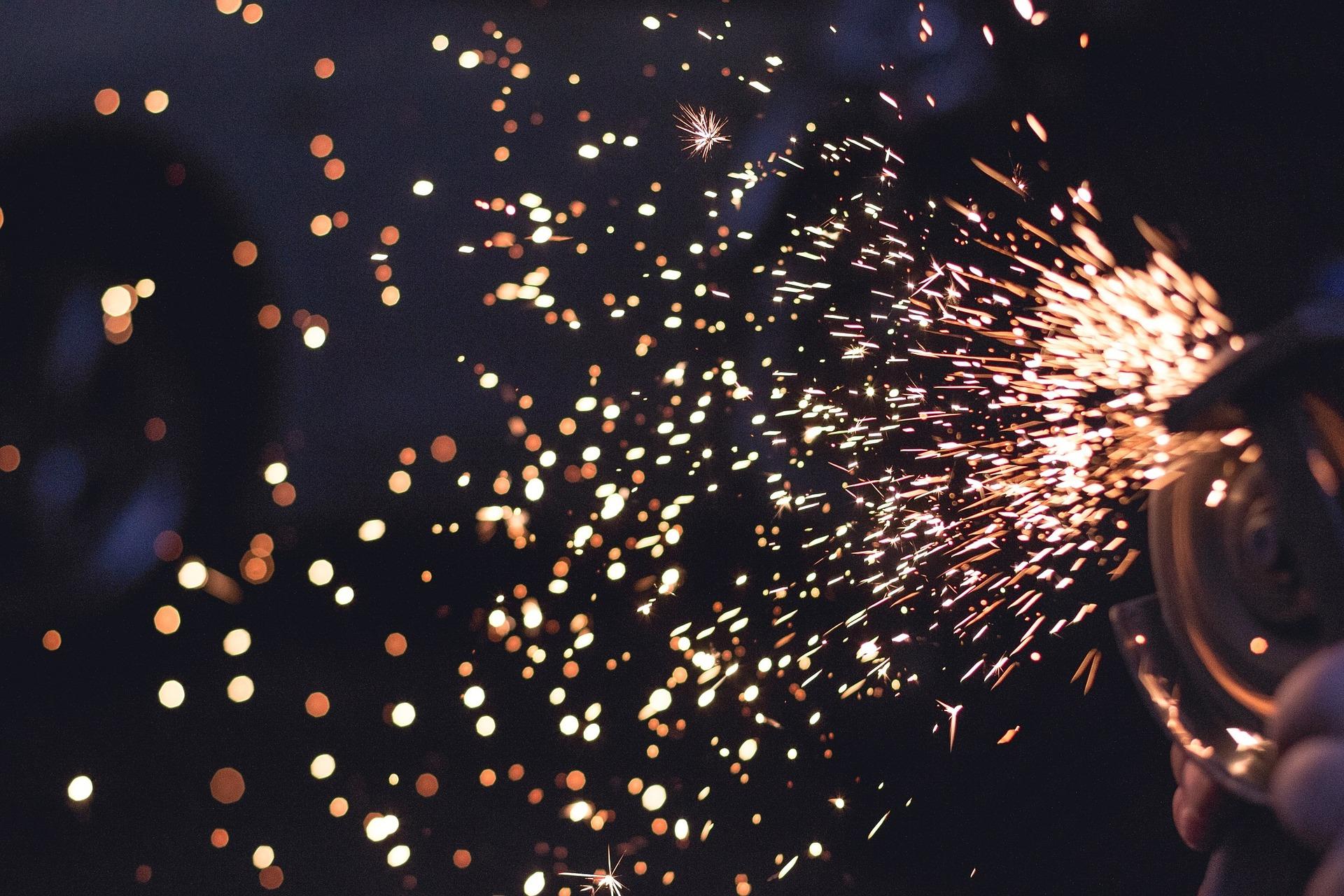 sparks from welder manufacturing metal