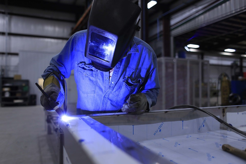 welding student practices welding a table